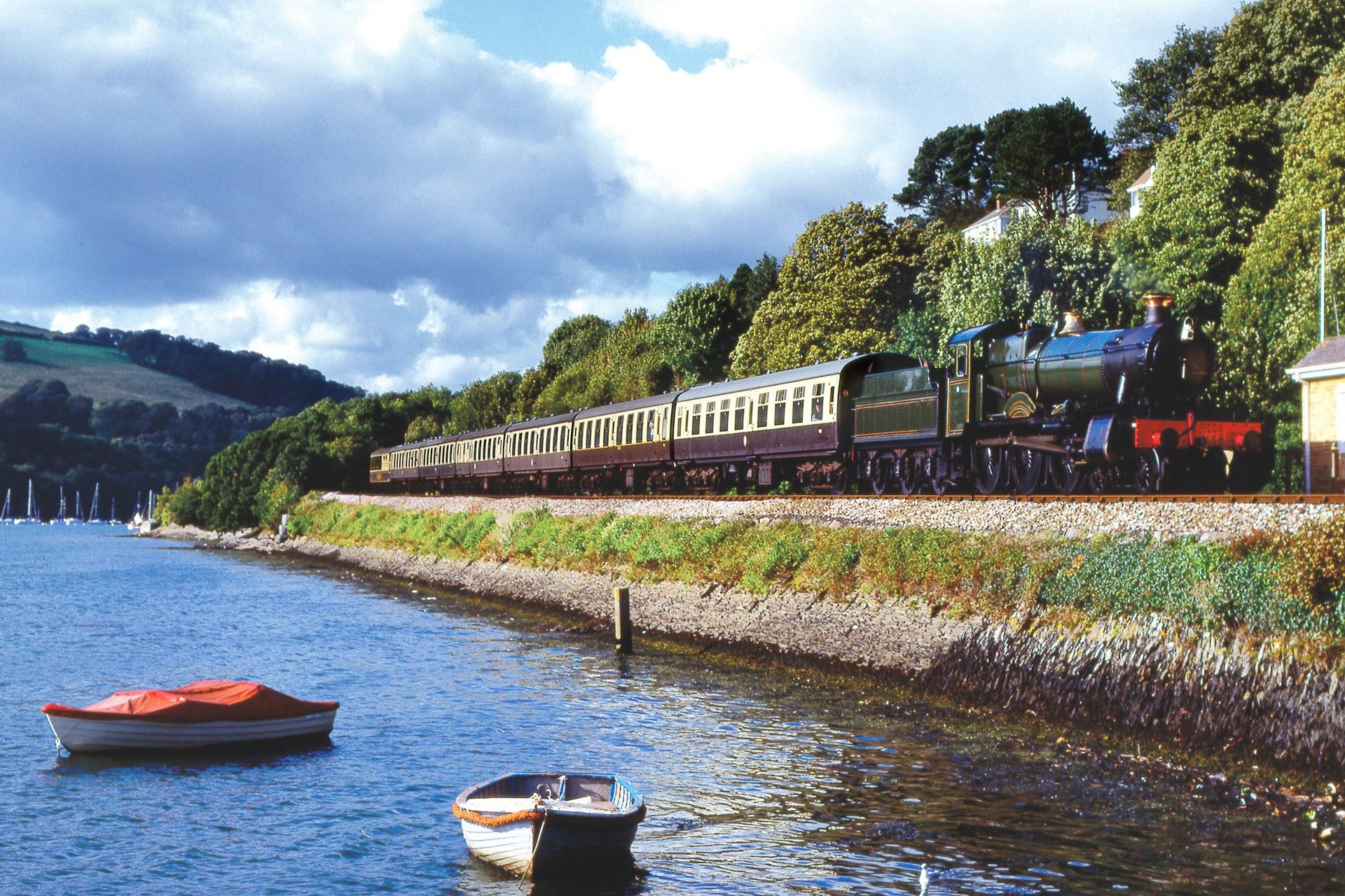 Steam train approaching Kingswear. Devon. England